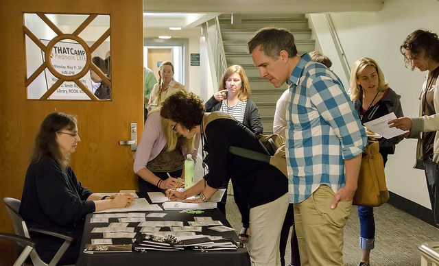 Registration & welcome desk. Photo by Susan Sharpless Smith, also available on Flickr.